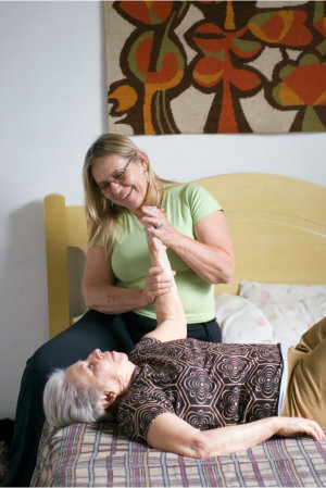 patient having an arm exercise with her therapist