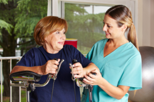 caregiver assisting patient to exercise