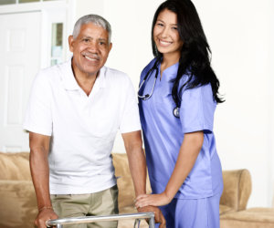caregiver and old man standing